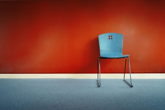 Red chair before blue wall